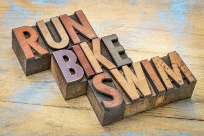 Triathlon Concept - Run, Bike And Swim Word Abstract In Vintage Letterpress Wood Type Printing Blocks